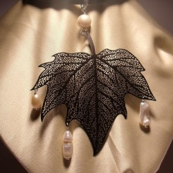 Pendant with freshwater pearl and metal leaf